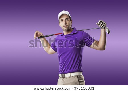 Golf Player in a purple shirt taking a swing, on a purple Background. - stock photo