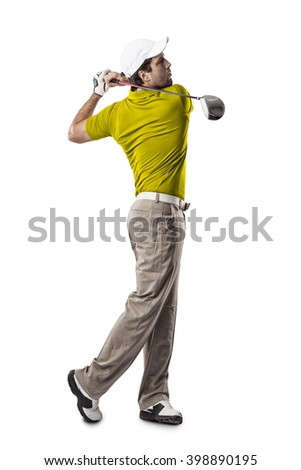 Golf Player in a yellow shirt taking a swing, on a white Background. - stock photo