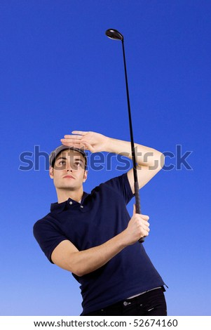 Golf player looking after the ball after a long drive - stock photo