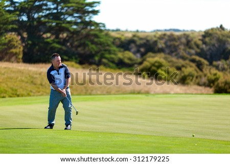 Golf player on the golf field. Cape Kidnappers golf court. New Zealand. - stock photo