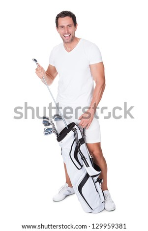 Golf Player Removing Golf Club From Golf Bag On White Background - stock photo