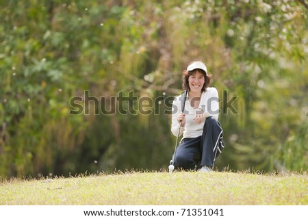 Golf Player Woman - stock photo