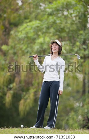 Golf Player Woman,Golf sport is Balance of Yin Yang.copy space left and right for adding text.