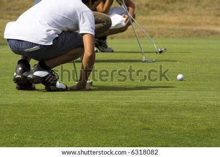 Golf players in the green - stock photo