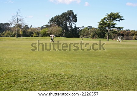 golf players on the green