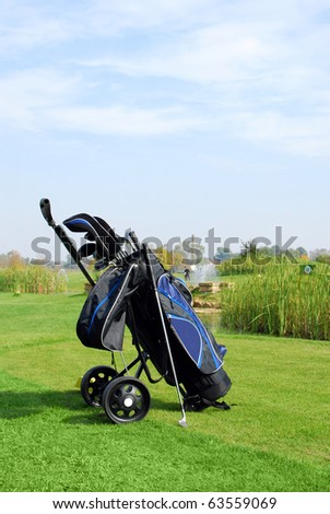 golf scene with bag and golf club - stock photo