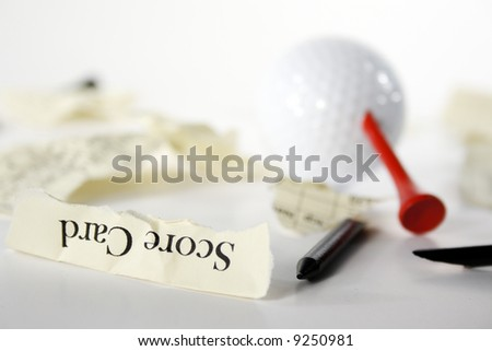 Golf score card teared apart, with peg through ball, due to bad result - stock photo