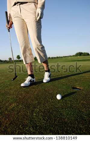 Golf serie, woman playing golf on a course