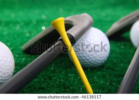 golf set laying on grass focus on tee. - stock photo