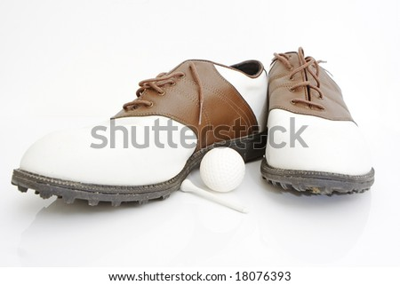 golf shoes ball and tee isolated against white background - stock photo
