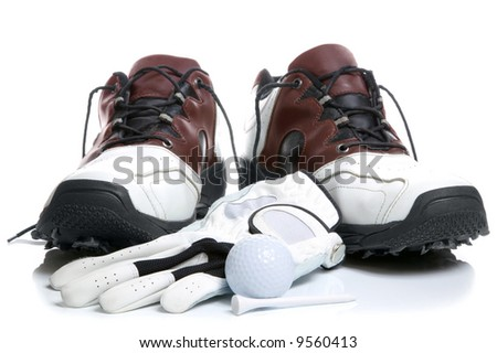 Golf shoes,Ball,Glove and Tee. Isolated on a white background. - stock photo