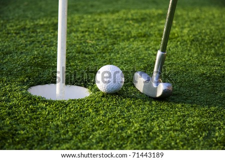 golf stick and ball - stock photo