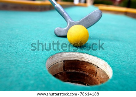 Golf stick and ball on green grass close up. - stock photo