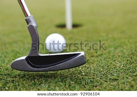 Golf Stick and Ball on the Green Grass - stock photo
