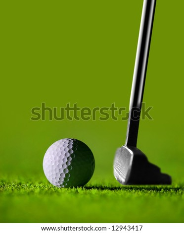 Golf Stick and Ball on the Green Grass with green background - stock photo