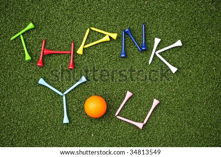 golf tees spell out thank you - stock photo