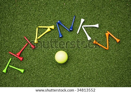 golf tees spelling out Thanks with golf ball - stock photo