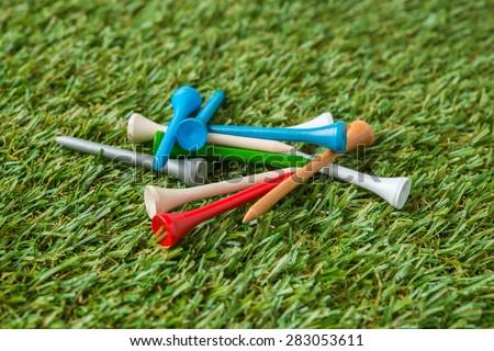 golf wood tee on grass - stock photo