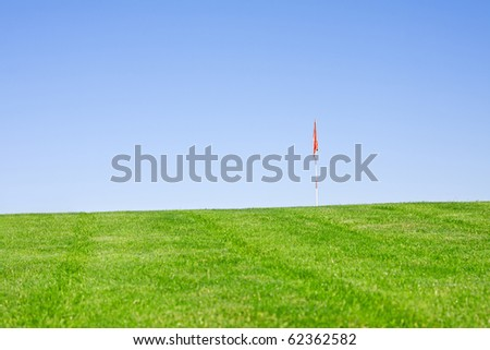 golfball in focus in green fields - stock photo