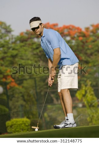 Golfer about to strike