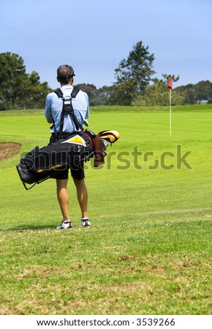 Golfer checking out the green - stock photo
