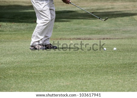 Golfer chipping the ball