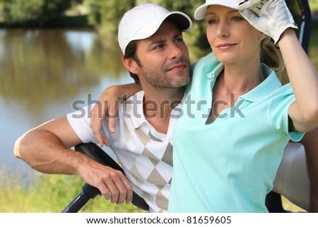 Golfer couple - stock photo