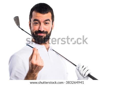 Golfer doing a money gesture - stock photo