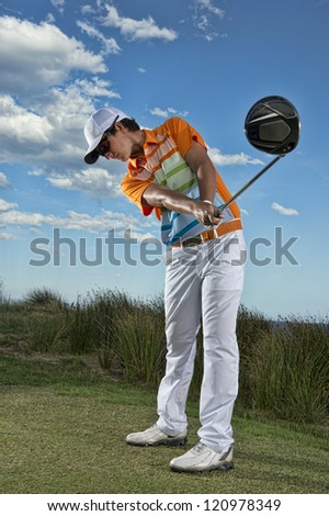 Golfer drives from the tee - stock photo