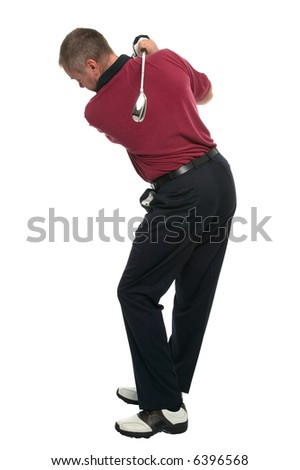 Golfer during the back swing of an iron shot, his eye still on the ball. - stock photo