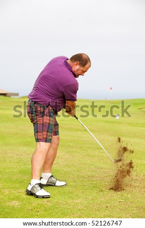 Golfer hitting the ball from the fairway. - stock photo