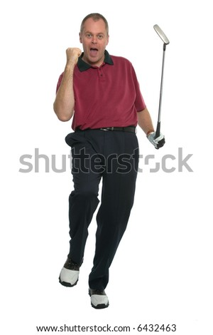 Golfer in a red shirt celebrating after sinking a great putt. - stock photo