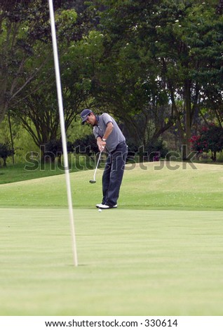 golfer in the putt - stock photo