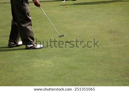 Golfer, Man swinging golf club with and driving the golf ball with extreme accuracy and skill sinking a HOLE IN ONE on 7 of the 9 holes he played. Golf is loved by millions around the world - stock photo