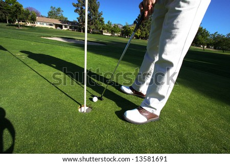 Golfer On Putting Green - stock photo
