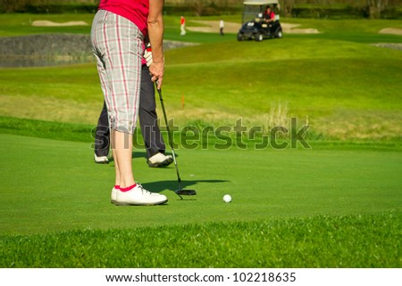 Golfer on the course at the hole