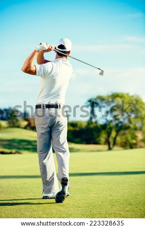 Golfer Playing on Beautiful Golf Course  - stock photo