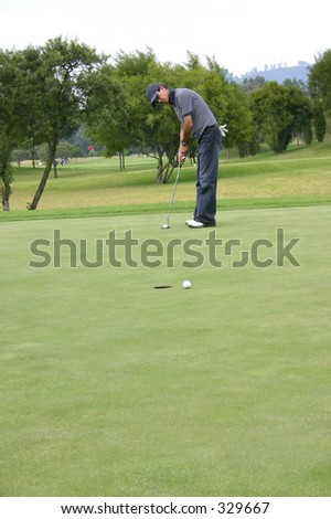 golfer practicing - stock photo