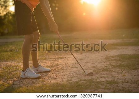 Golfer preparing to hit the ball a sunny position. - stock photo