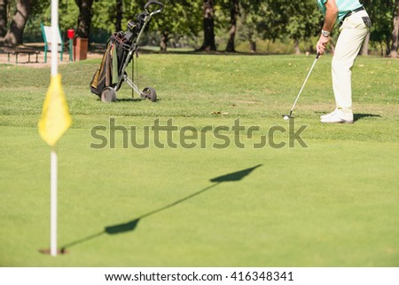 Golfer putting - stock photo