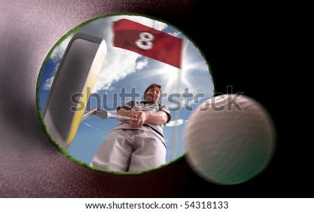 golfer putting inside the hole - stock photo
