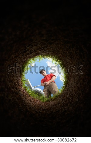 golfer putting, view from inside the hole - stock photo