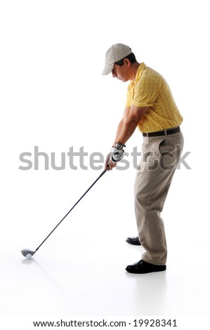 Golfer ready to swing isolated against a white background - stock photo
