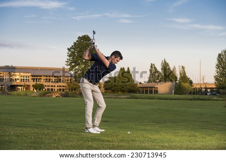 golfer's approach shot / hey let's use some caution here / i see some hazards - stock photo