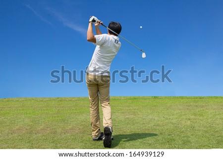 Golfer shooting a golf bal - stock photo