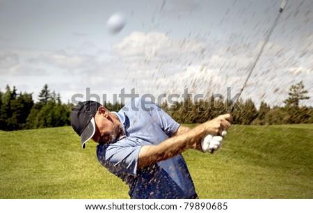 golfer shooting a golf ball - stock photo