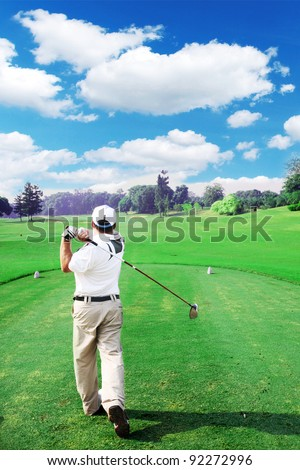 Golfer swing with driver - stock photo