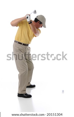 Golfer teeing off in a studio setting isolated on a white background - stock photo