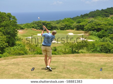 Golfer trying a par 3 on a course in Jamaica