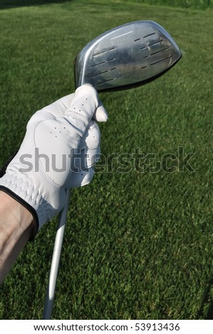 Golfer Wearing a Golf Glove Holding a Metal Driver - stock photo